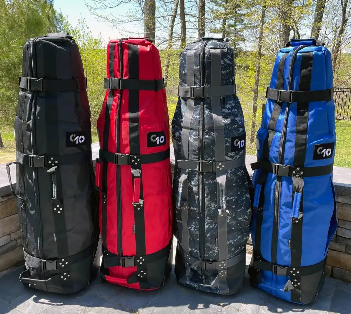 All four CHARLIE10 golf travel bags outdoors