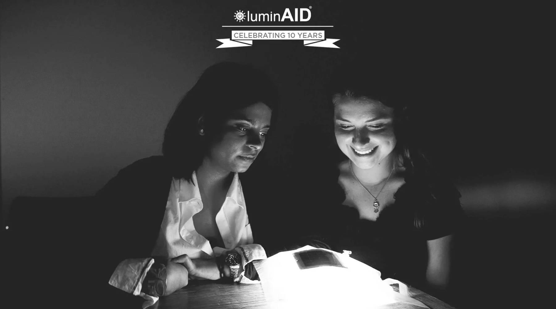 Anna and Andrea around lantern prototype.
