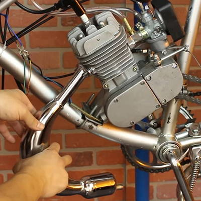 An upgraded exhaust muffler on a motorized bike.