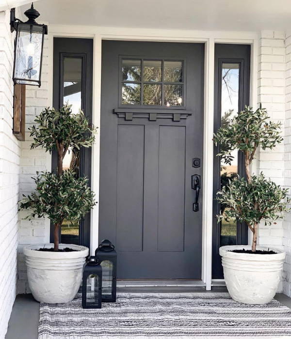 Two artificial olive trees from Nearly Natural decorated next to entrance door