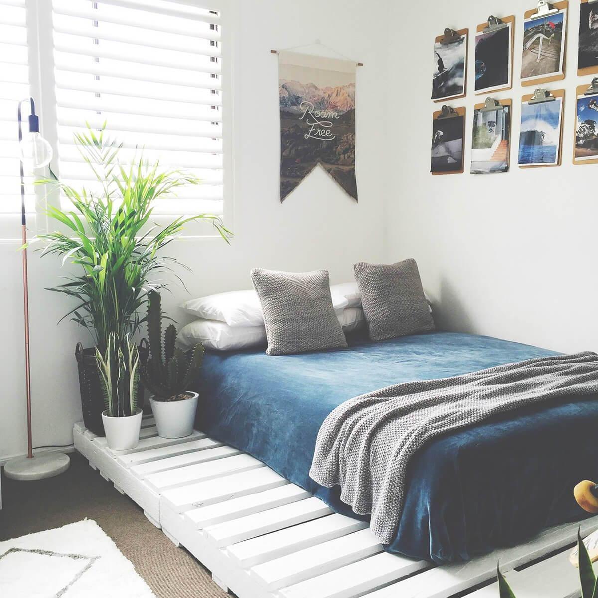 white pallet bed base on the floor