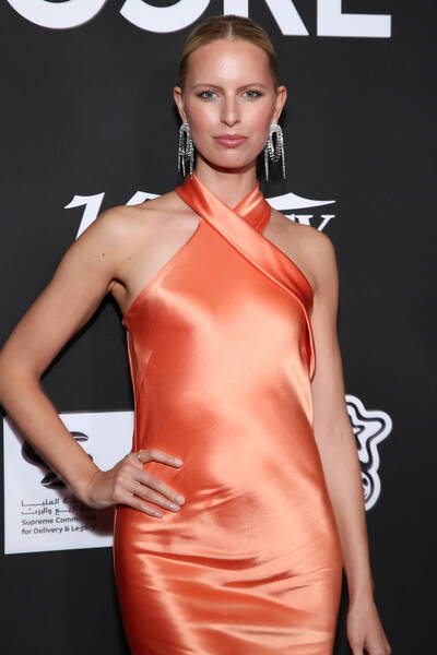 Karolina Kurkova at the 10th Anniversary CORE Gala wearing Galvan London Asymmetrical Halter Neckline Orange Dress