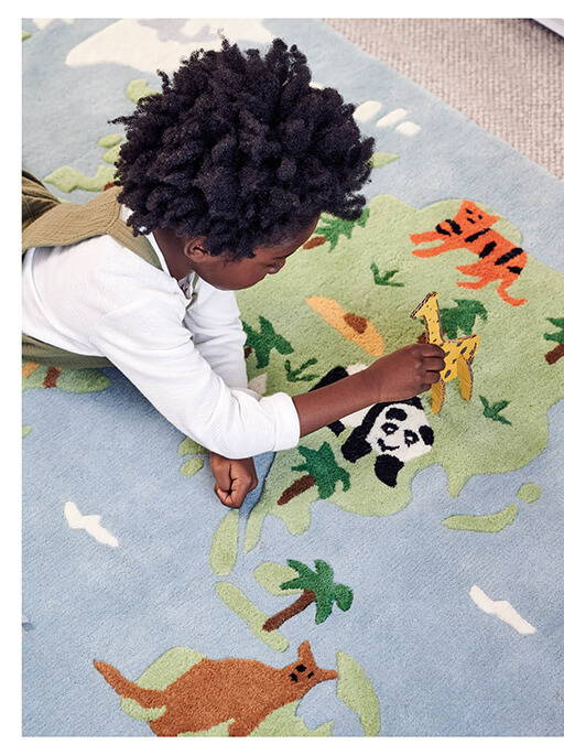 Young boy playing on Around the World rug