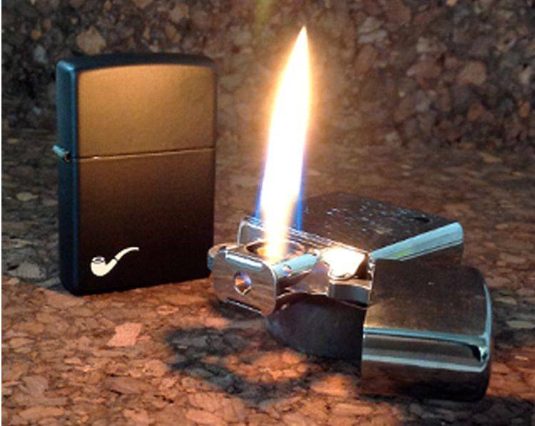 Image of Black Matte lighter standing next to a lit pipe lighter insert that is laying flat