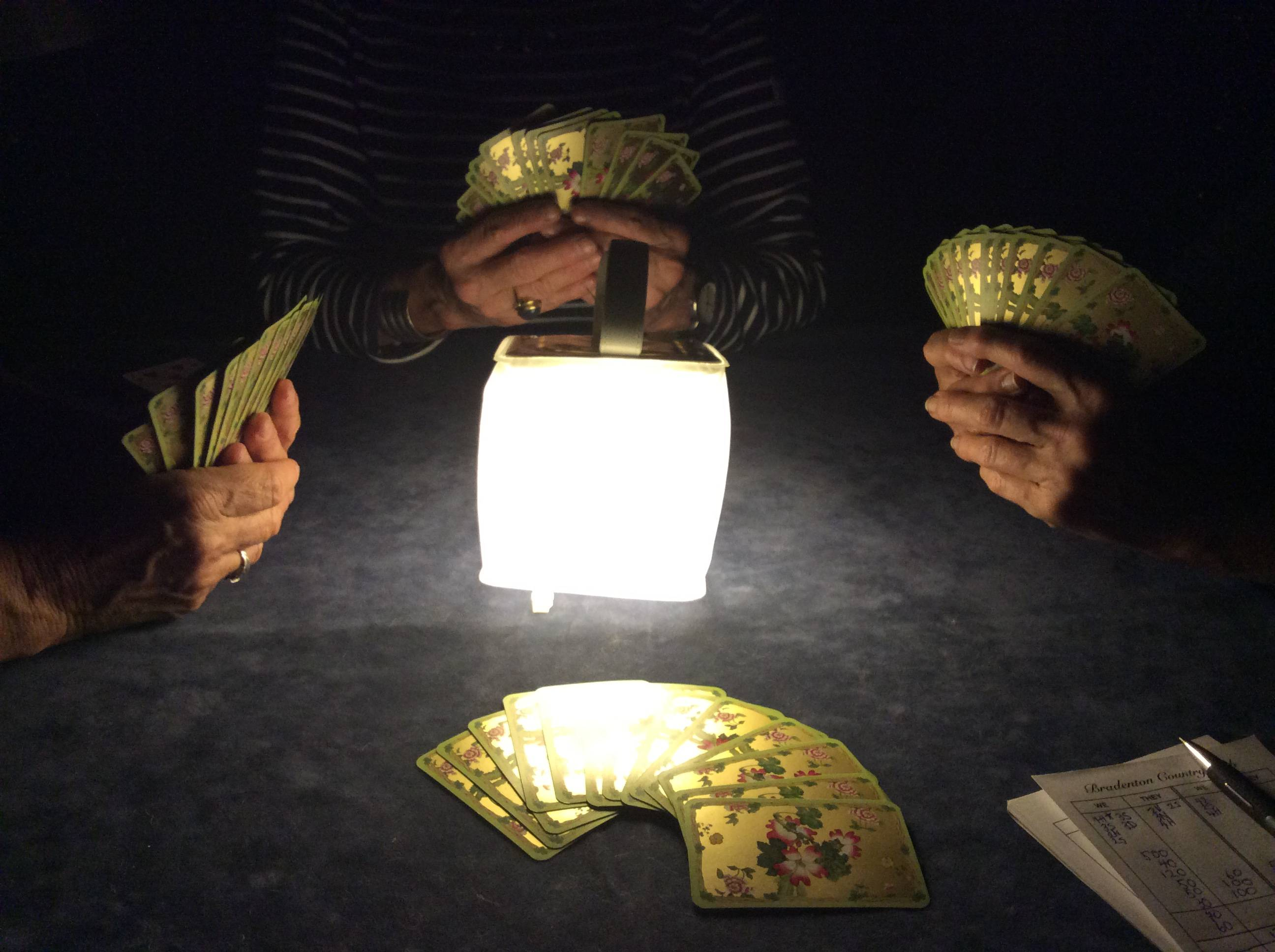 Play cards in the dark with your LuminAID lantern.