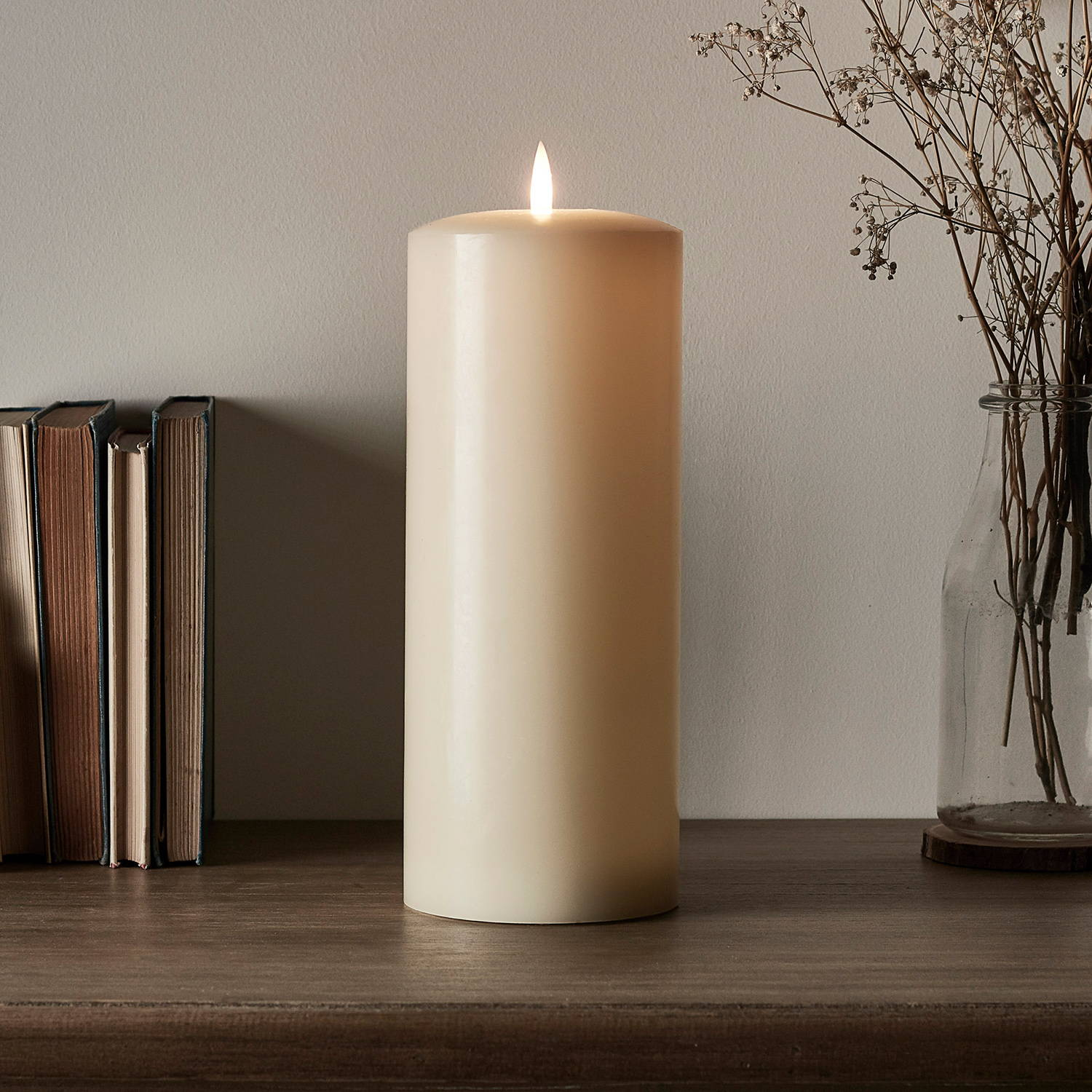 Ivory TruGlow chapel candle on table