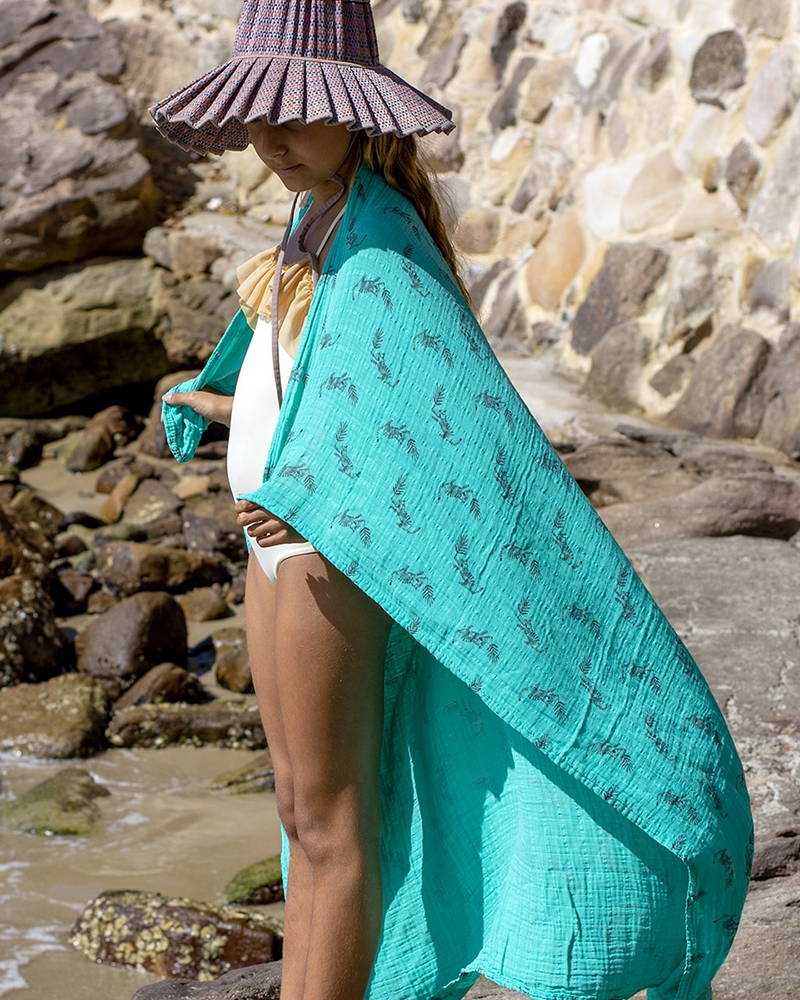 Styled photography of Rose in April baby muslins used at the beach