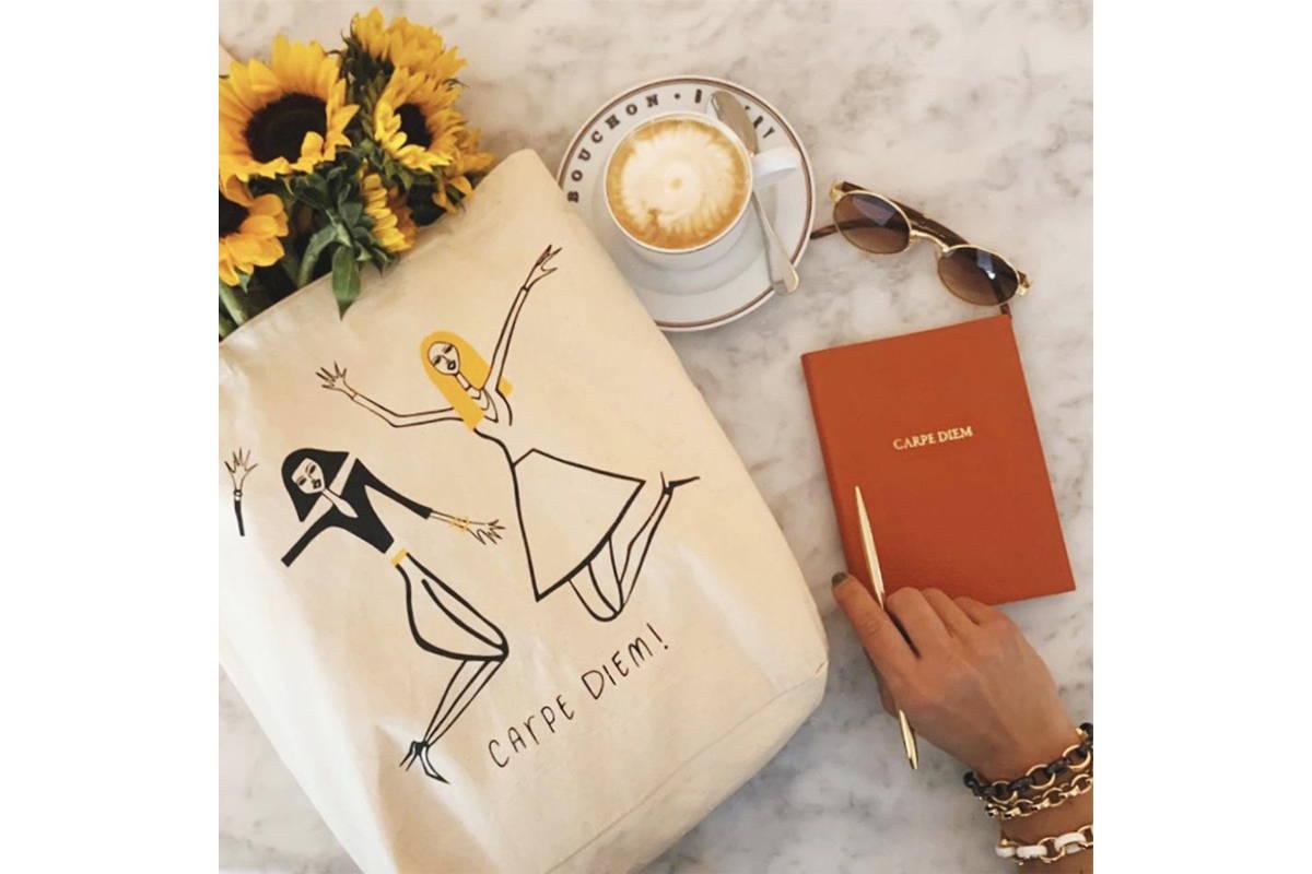 Monica Rich Kosann carpe diem tote bag with coffee and a notebook