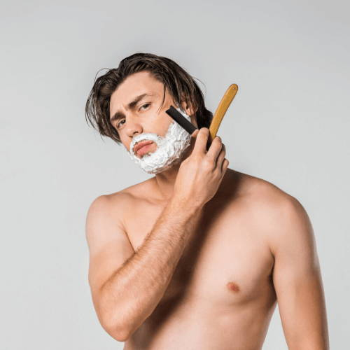 Man Wet Shaving with Straight Razor