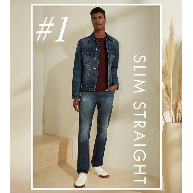 a man wearing slim straight denim jeans