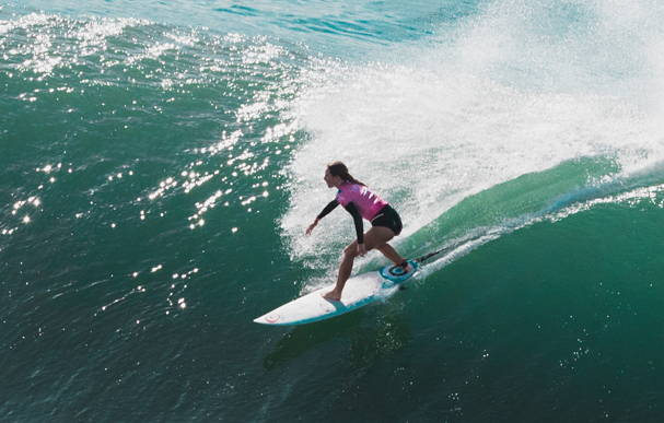 Nikki van Dijk attacks the surf at the first-ever Beachwaver Maui Pro Women's Surf Championship