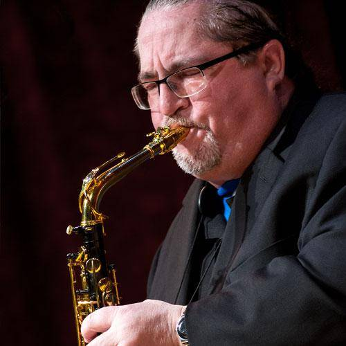 Miles Osland playing saxophones