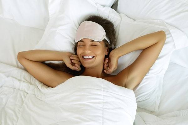Girl waking up after good sleep