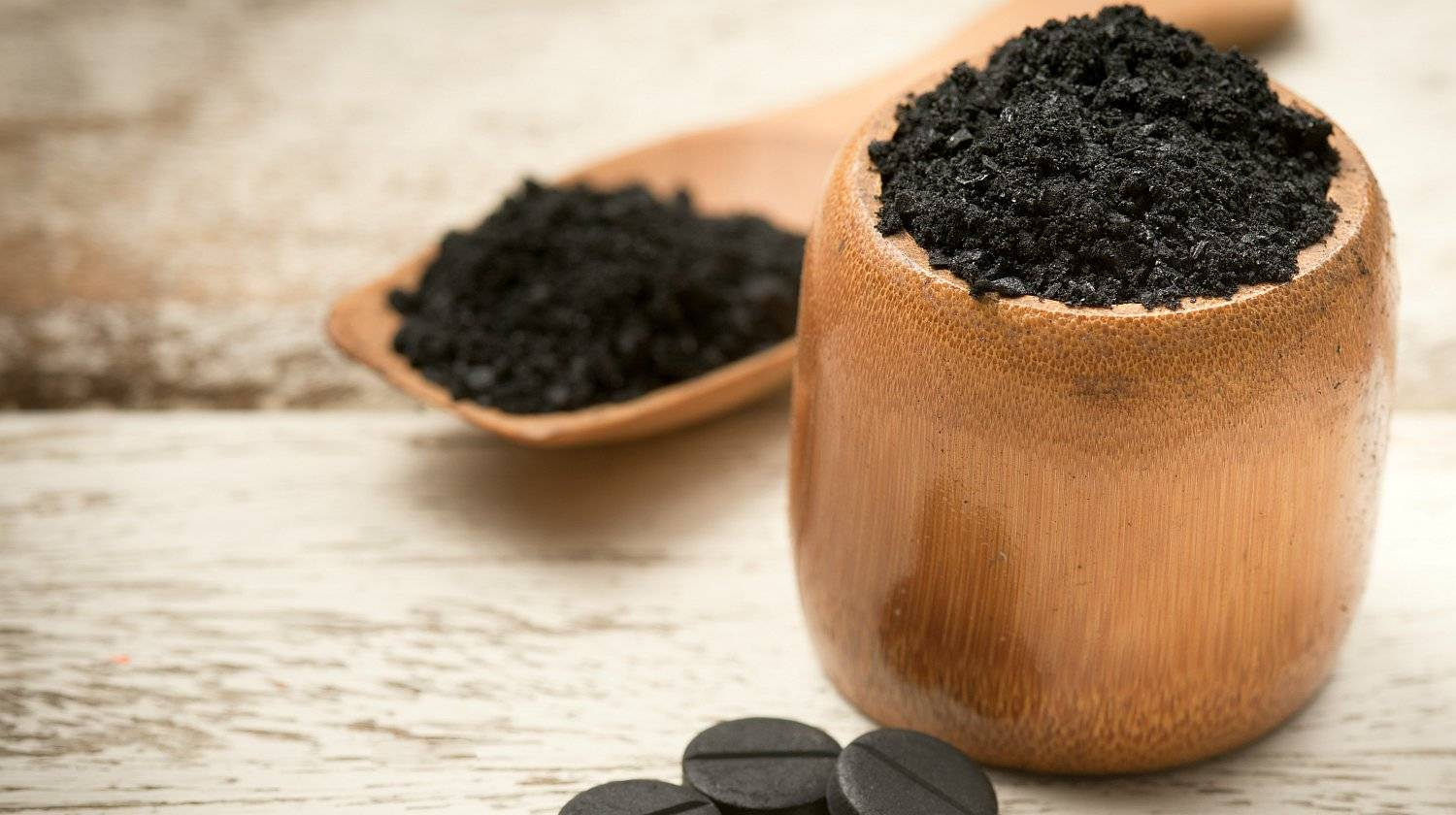 Activated carbon on white | What The Heck Is Activated Charcoal & Why Is It Good Or Not | activated carbon charcoal | Featured