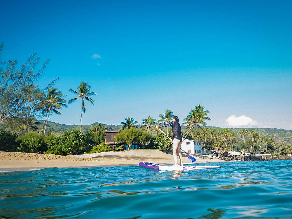 Paddling the Pau Hana Moonmist TPU board on the sea