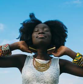 happy-woman-wearing-african-jewelry