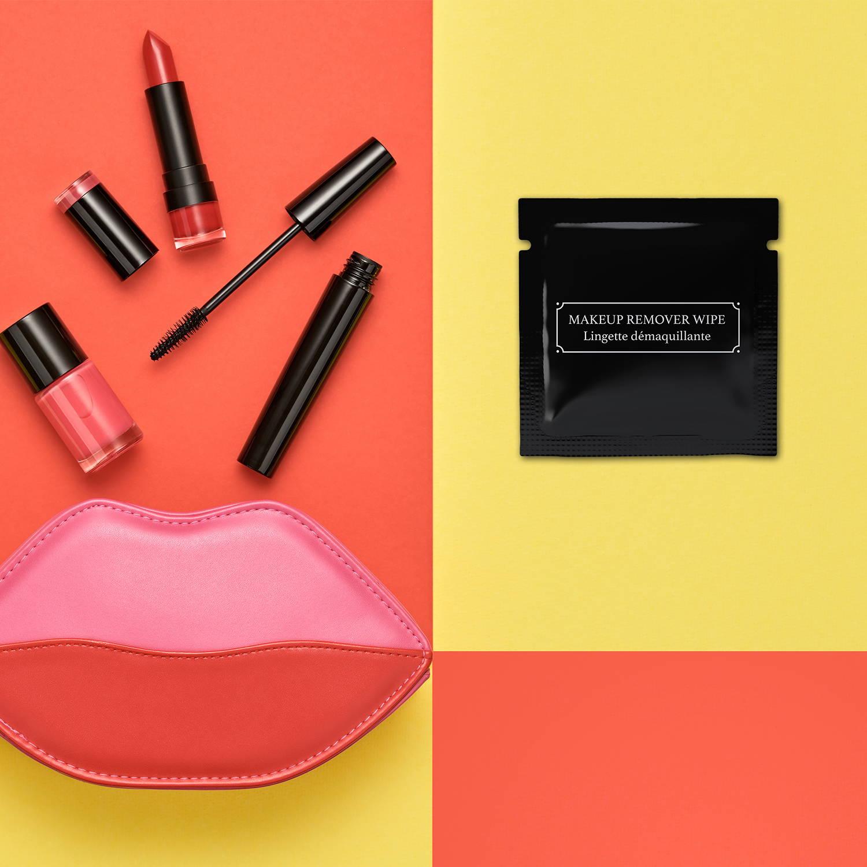 Black LA Fresh makeup wipe on warm colorful background