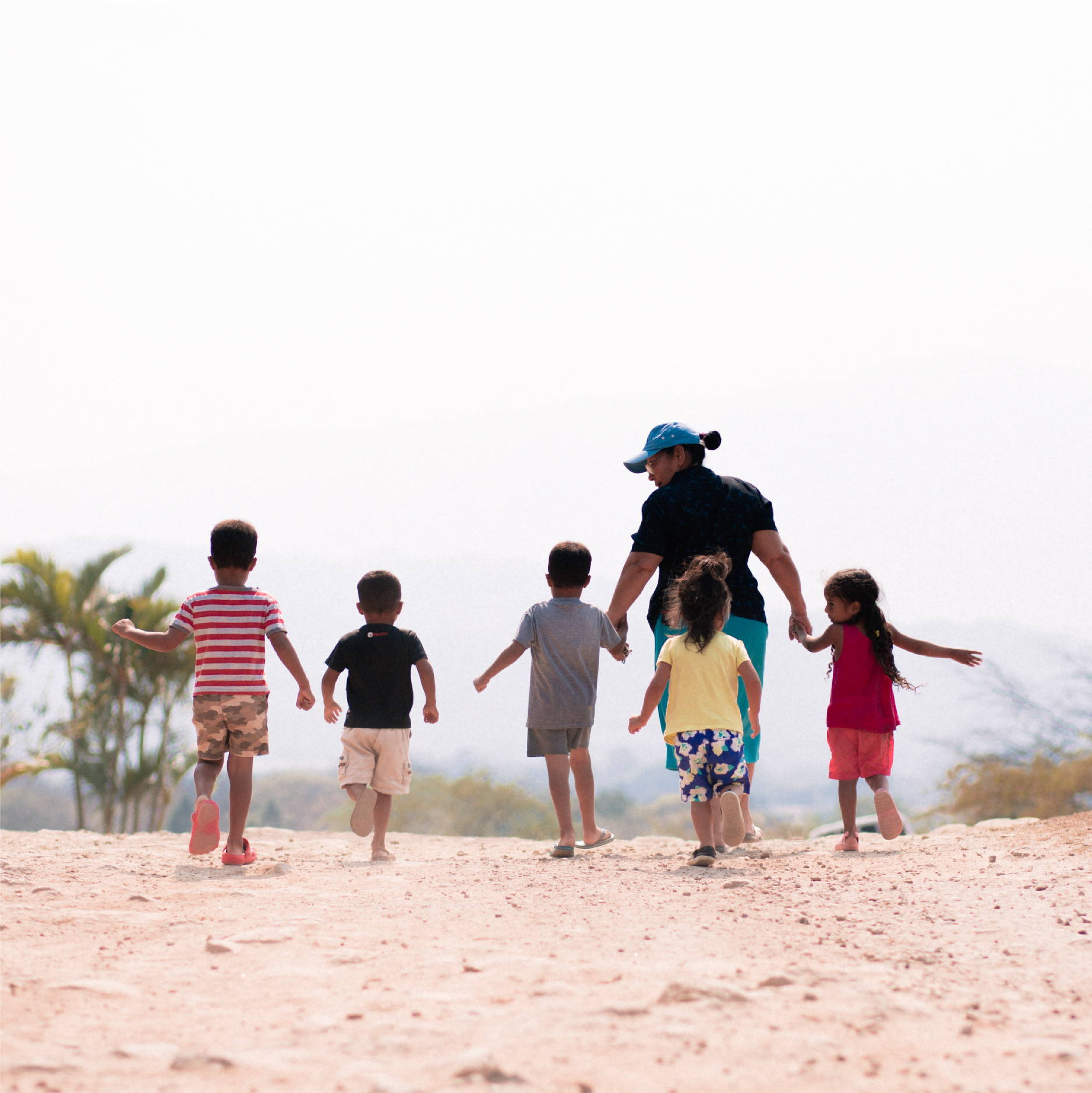 A group of young children walk with their tia to the Comador at Good Shepherd Children's Home in Zamarano Valley, Honduras