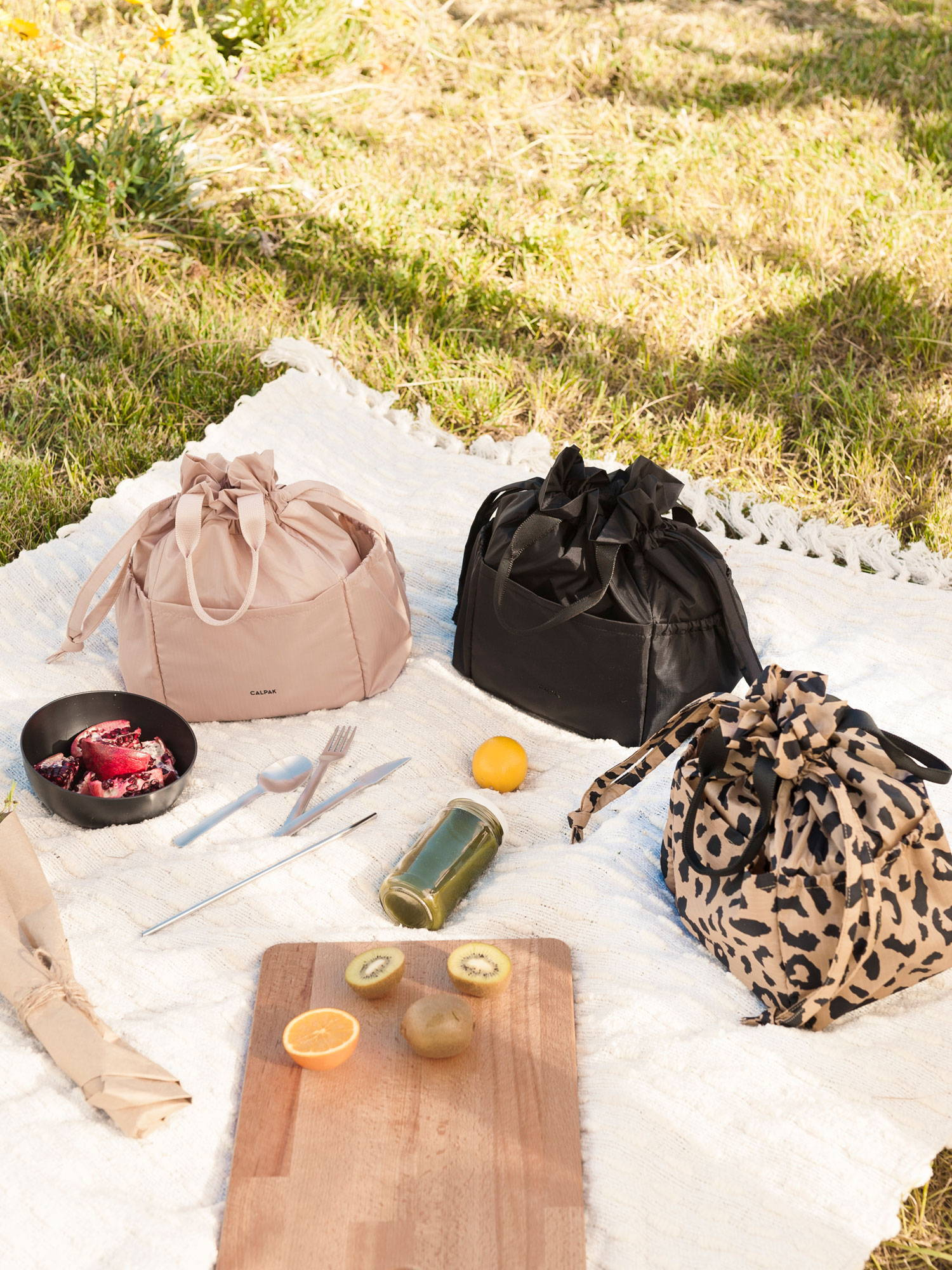 Group shot of all three Insulated Lunch Bags in Mauve, Black, and Cheetah