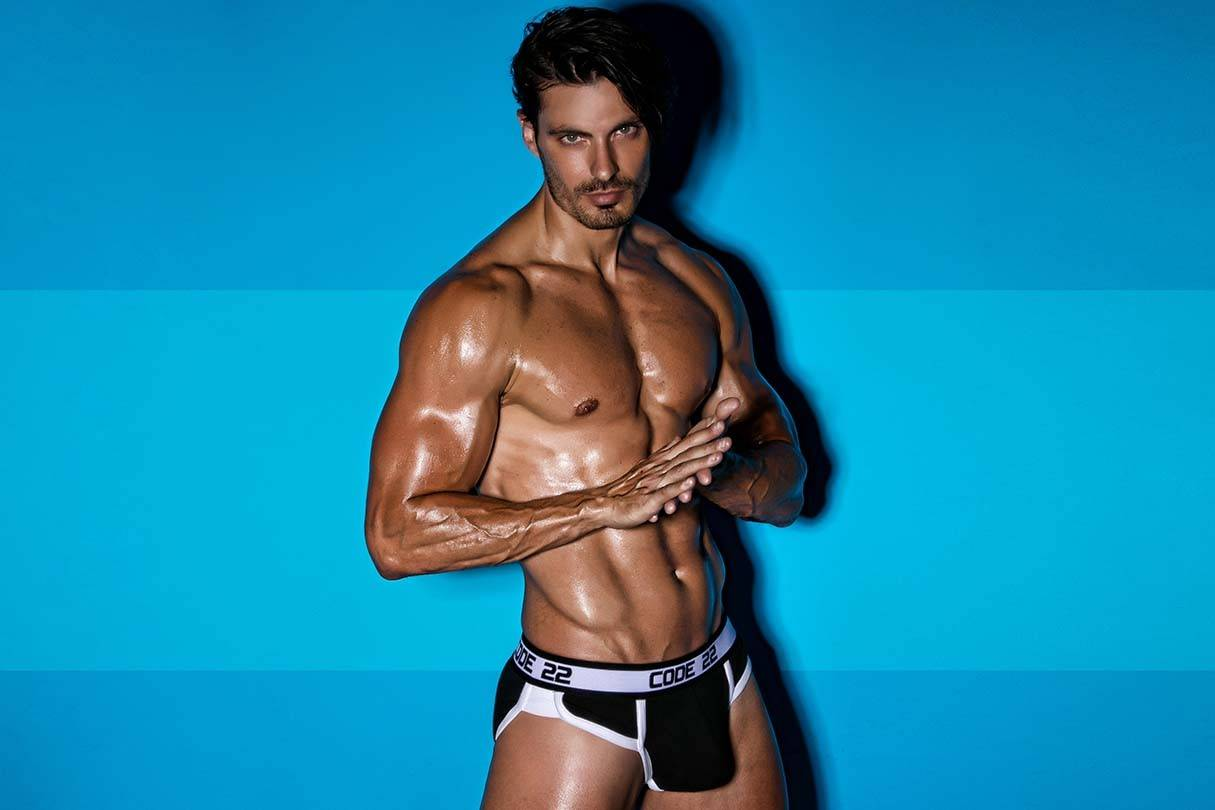 Code 22 Mens Underwear, Sportswear and Swimwear | It's About The Man | Male Model wearing Code 22 Black Briefs, Shirtless Model, Six Pack Male Model