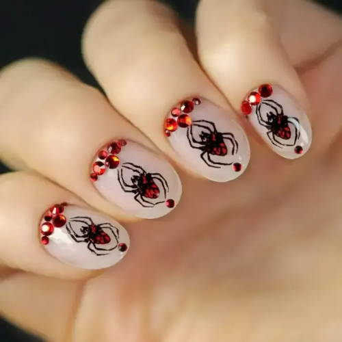 nails with red spiders design