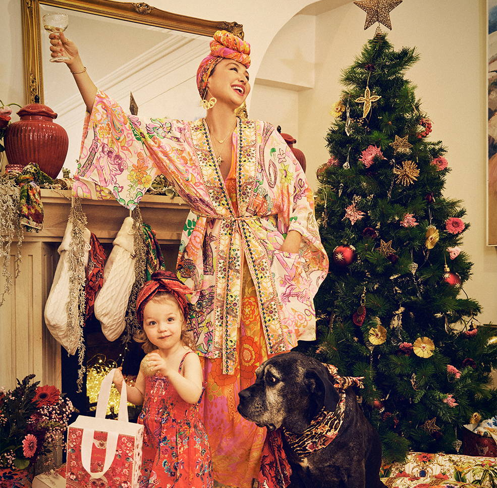 CAMILLA next to Christmas tree and Luna wearing 70's inspired prints