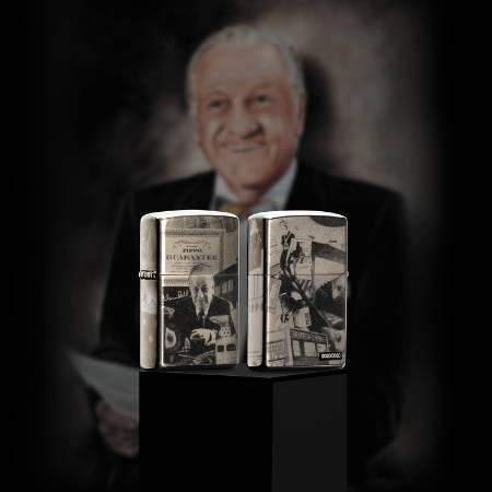 George Blaisdell 125th Birthday Anniversary Lighter standing on a pedestal with a photo of George G Blaisdell in the backgrounds