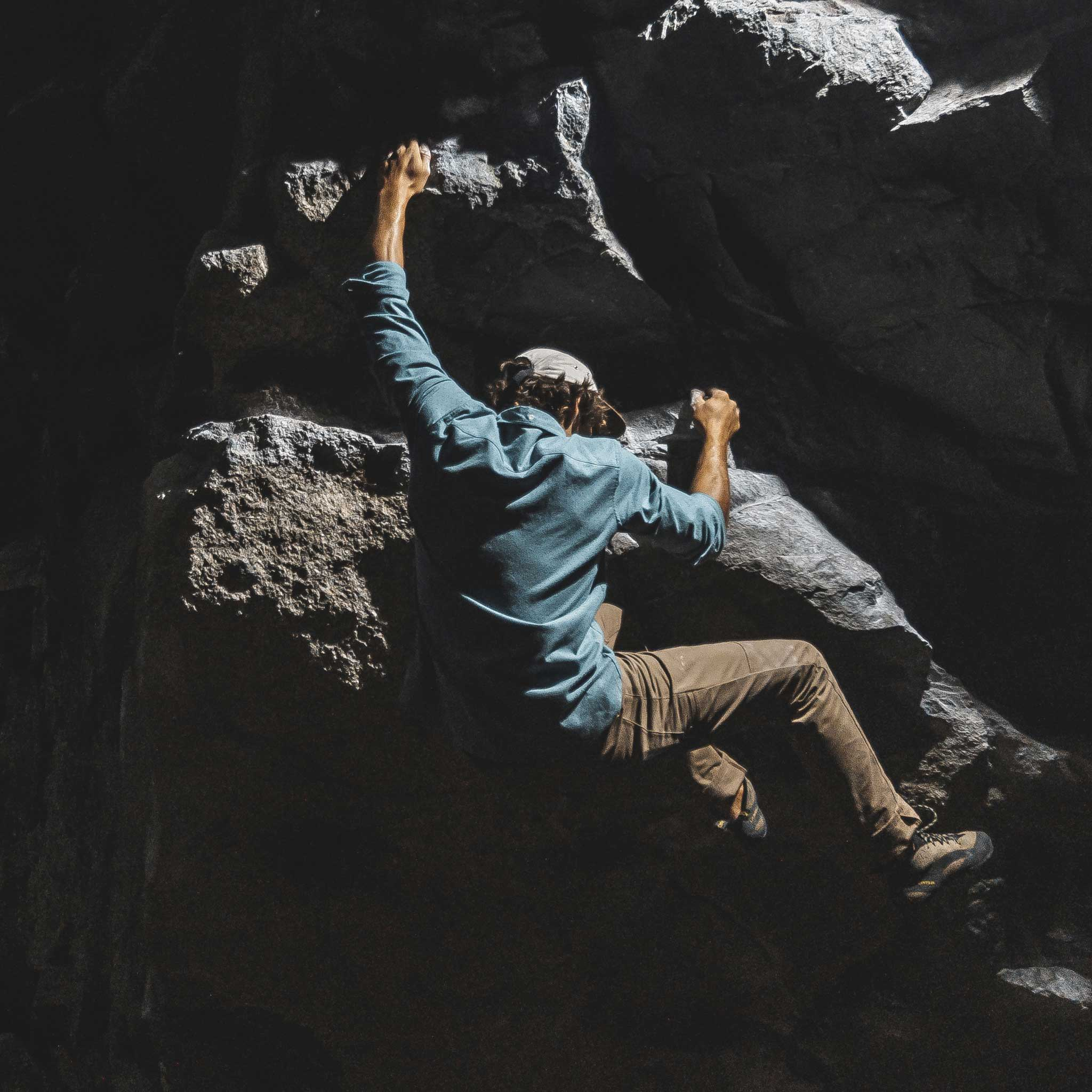 Man bouldering while wearing Collins Flannel Shirt