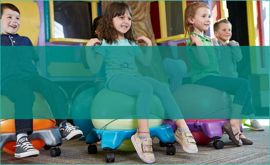 group of kids sitting on balance ball chairs