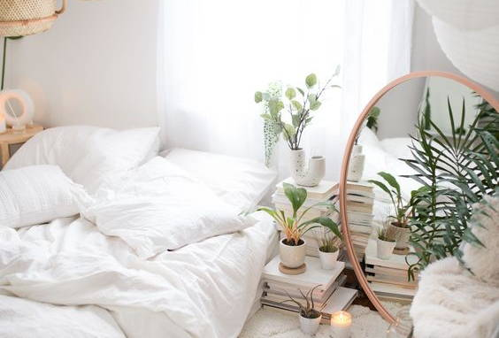 Beautiful bedroom in white Eucalypso sheets furnished with plants