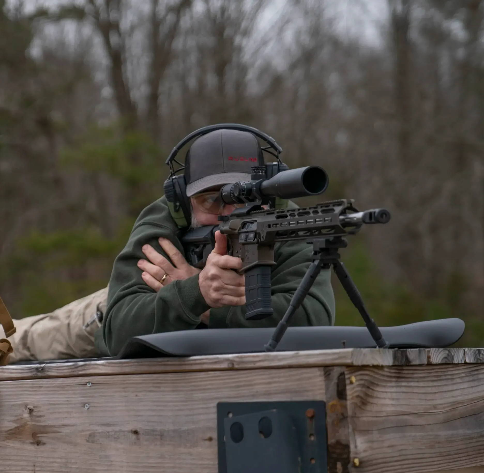Man shooting with ISOtunes Sport DEFY hearing protectino