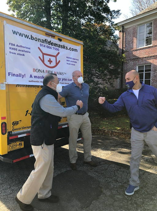 Bill and Jim Taubner of Bona Fide Masks deliver 50,000 masks that the company is donating to the New Canaan Police Department. Lt. Jason Ferraro pictured at right.
