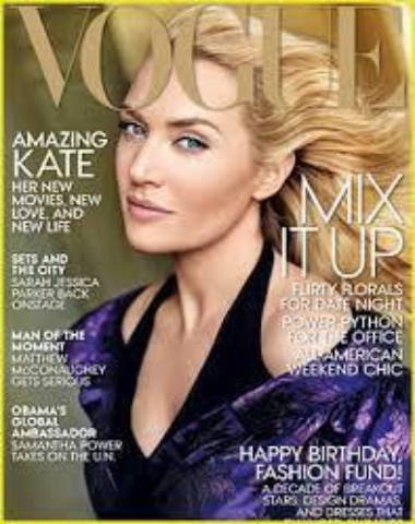 Vogue magazine cover with Kate Winslet in purple and black top with windblown hair