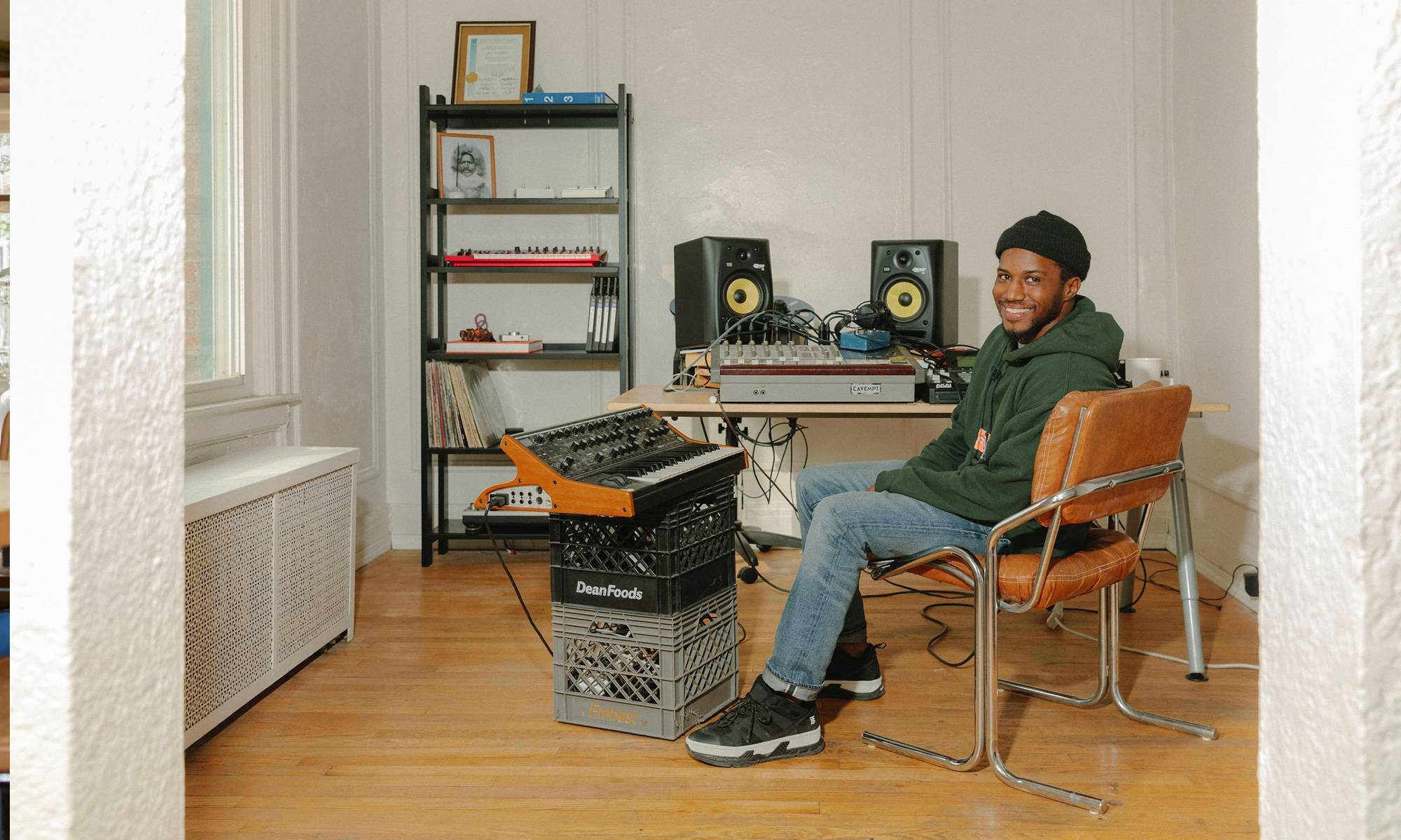 Jay Daniel musician in his studio in Detroit with a Floyd shelf.