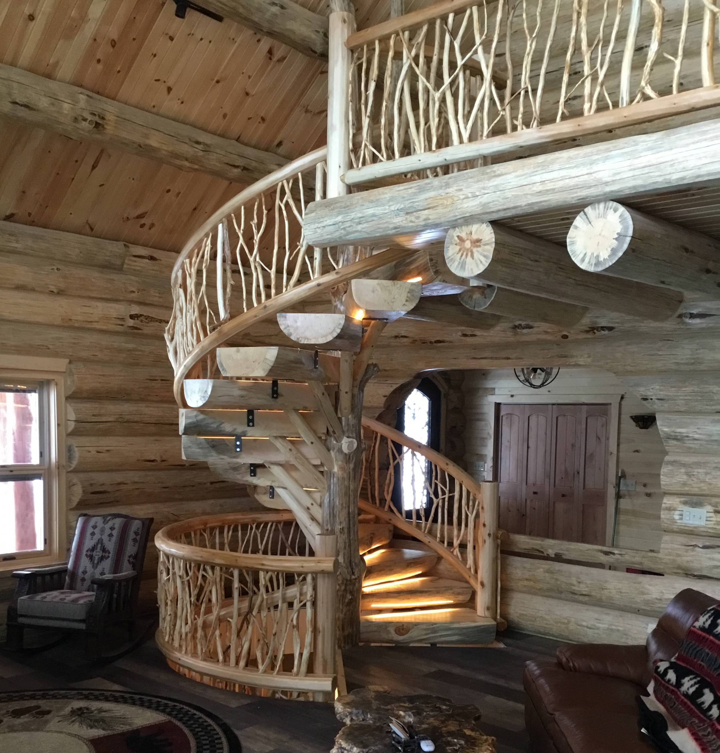 Spiral log stairs with twig railing