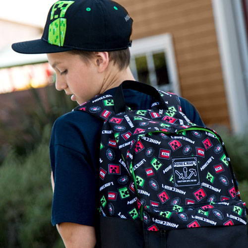 Boy wearing multicolor backpack photo.