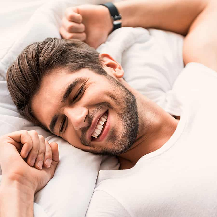 Image of a happy man sleeping.