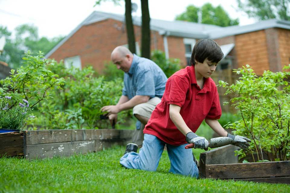 Family finding healthy activities gardening together