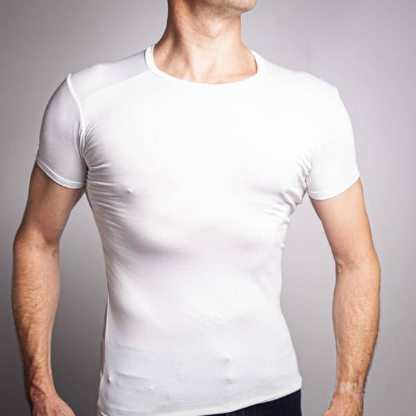Man wearing a white crew neck undershirt and jeans