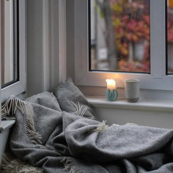 Hygge window seat with Gotland wool blanket and candle