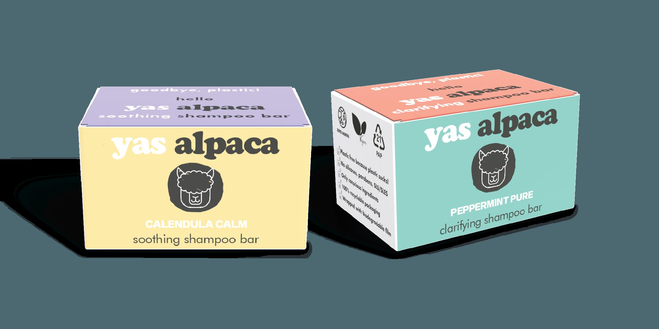 Packaging boxes of Yas Alpaca's Calendula Calm soothing shampoo bar and Peppermint Pure clarifying shampoo bar.