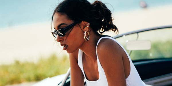 Model learning out of car wearing Ring Concierge hoops and ear cuffs