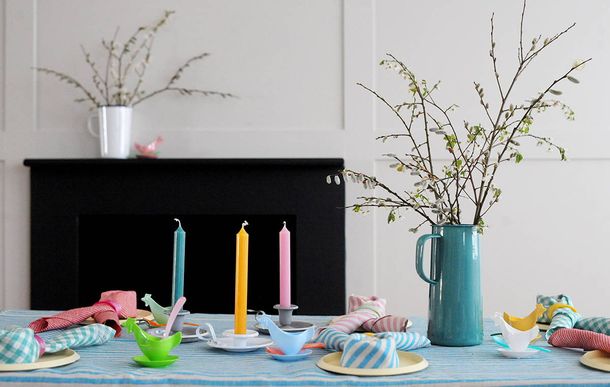 A dinner table laid with easter decorations