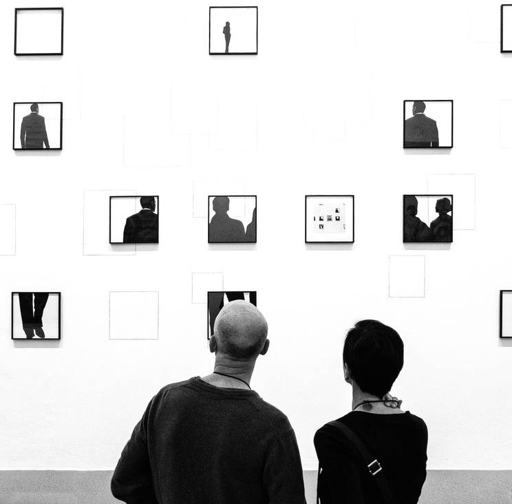 A couple in front of photo prints at art fair