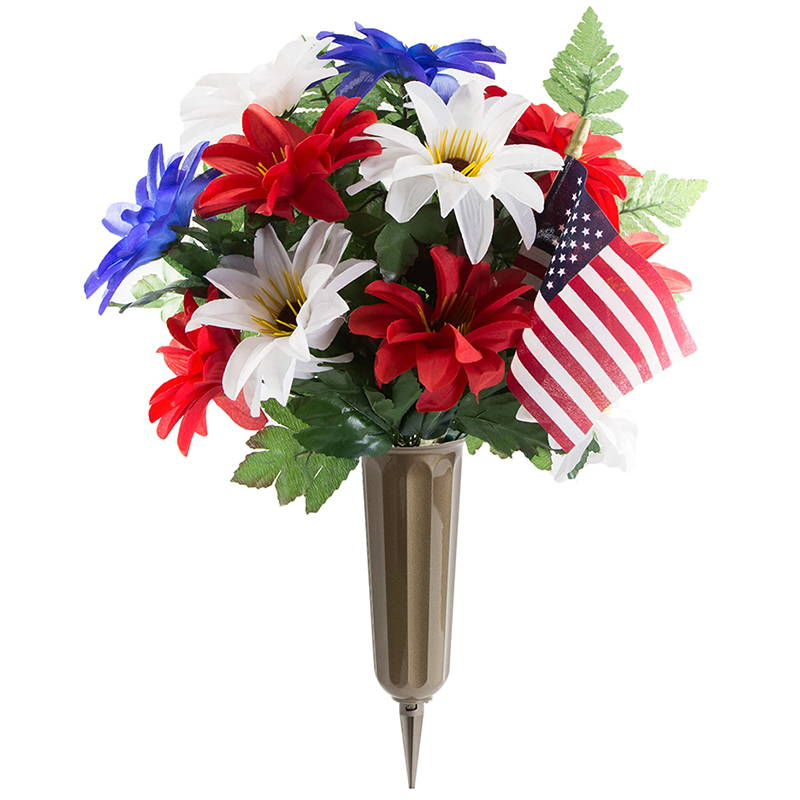 Flowers and USA flag coming out of a bronze metal cemetery vase