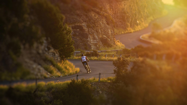 Bicyclist riding with thru axle