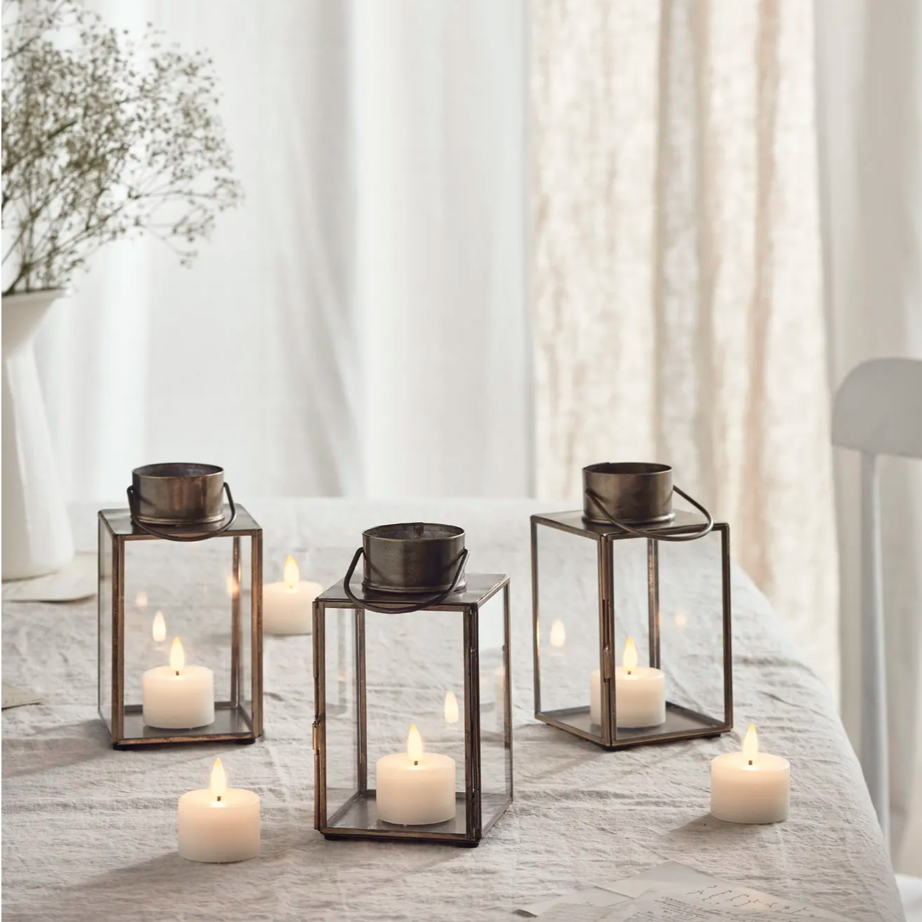 gota artisan truglow candle lantern trio set on table top