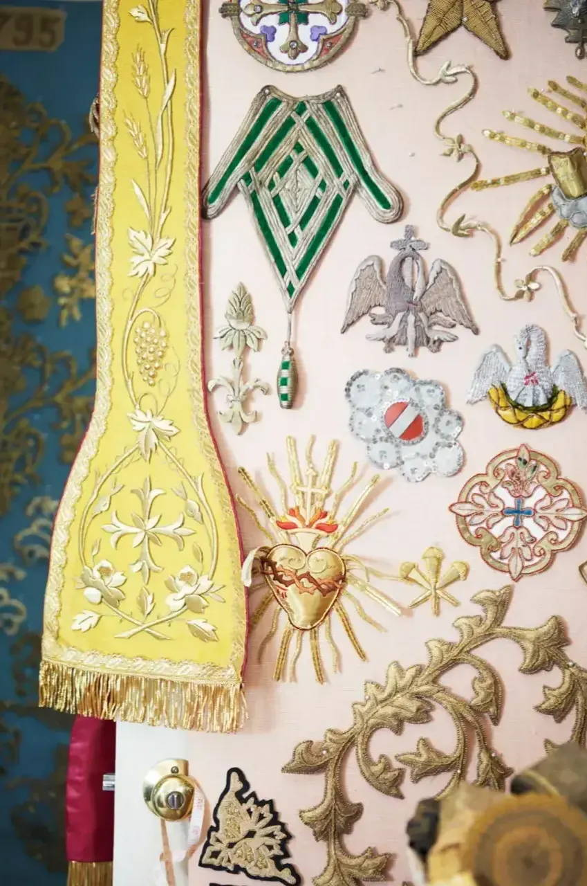 An array of vintage and antique embroideries and appliques is displayed in the B. Viz Design studio on Lake Bruin near St. Joseph, LA
