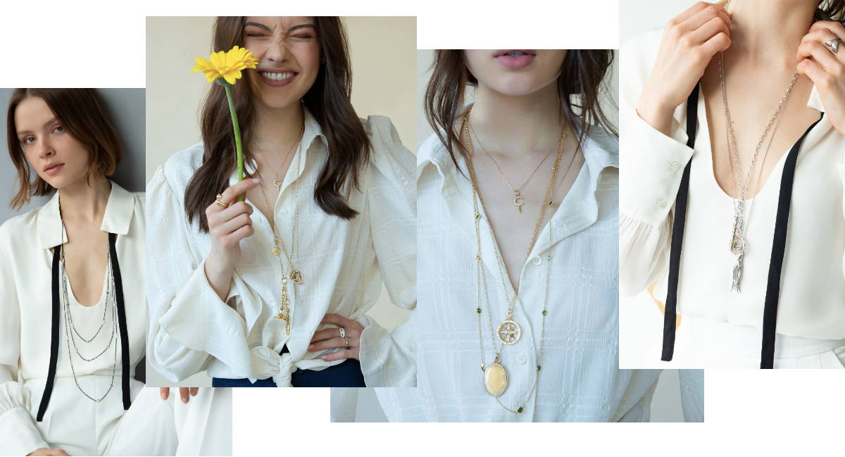 Long charm necklaces And Chains over a white blouse
