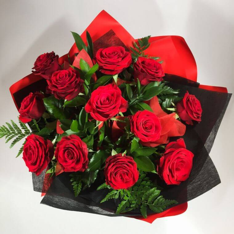 One dozen red roses for love